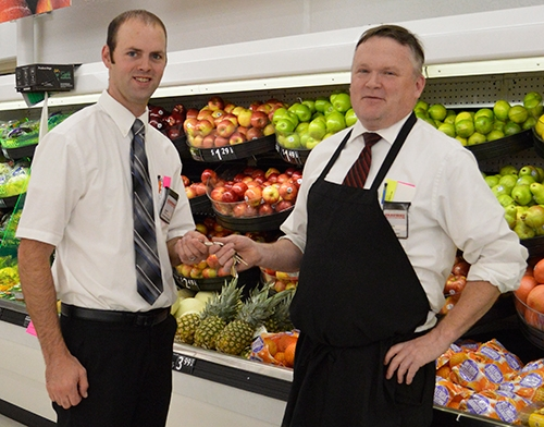 Waukon Fareway Store Manager Cleve Branan (right) hands keys to new Assistant Grocery Manager Adam Peters (left), who transferred from an Omaha, NE...