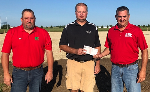 Bruening Rock Products, Inc. recently contributed a $5,000 donation to the tennis court project currently underway next to the Waukon High School...