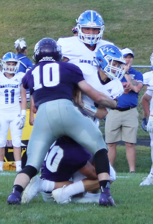Although opening the season with a loss a week earlier and facing the daunting task of hosting the defending State Runner-Up, the Kee football team...